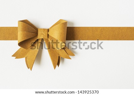 Blond ribbon on white recycled paper. Paper craft . - stock photo