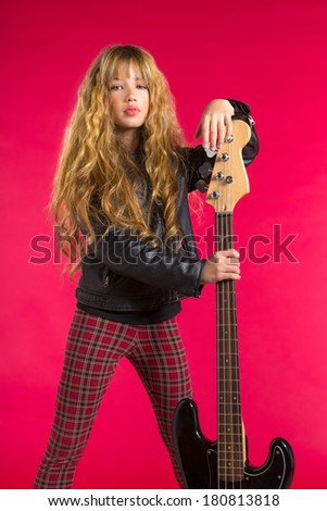 Blond Rock and roll girl bass guitar player portrait on red background - stock photo