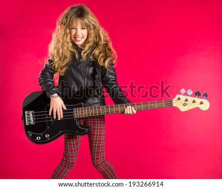 Blond Rock and roll girl playing bass guitar on red background - stock photo
