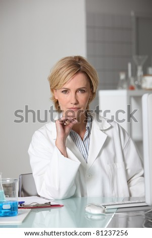Blond scientist in laboratory - stock photo