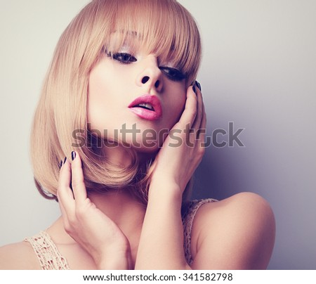 Blond short hair style woman with pink lipstick posing. Toned closeup portrait - stock photo