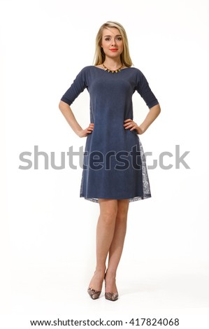 blond slavic business executive woman with straight hair style in summer blue short sleeve dress heel shoes going full body length isolated on white