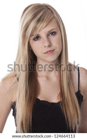 Blond teenage girl looking at camera with scowl, against white background.