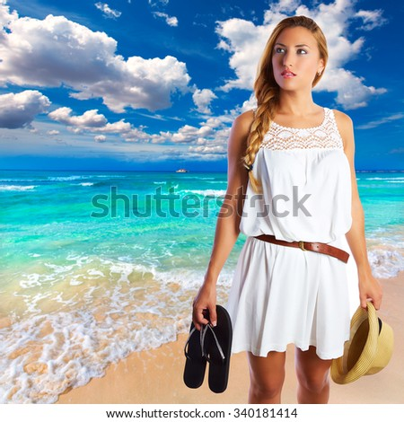 Blond tourist girl in Es Trenc beach of Mallorca photomount