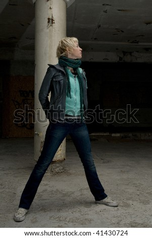 Blond urban woman in old building