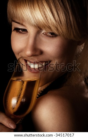 blond woman and glass of wine - stock photo