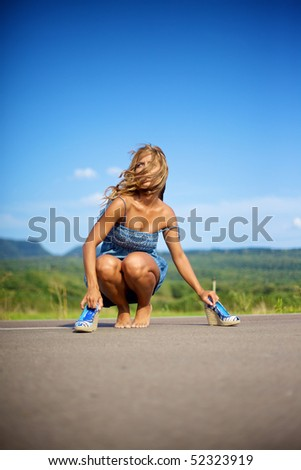 Blond woman barefeet on summer day