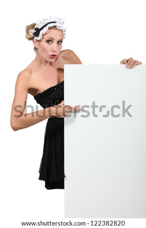 Blond woman dressed in maid costume - stock photo