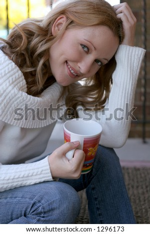 blond woman drinking morning coffee