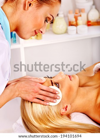 Blond woman getting head massage at spa.
