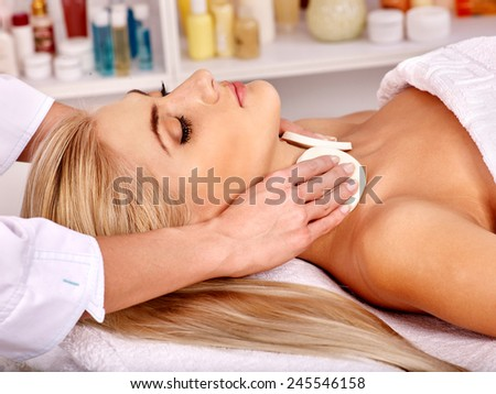 Blond woman getting head massage at spa. - stock photo