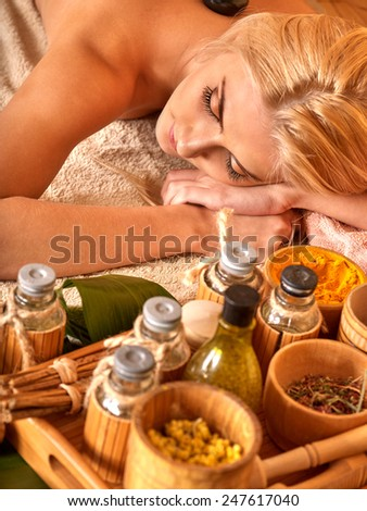 Blond woman getting massage in tropical spa. Cosmetics closeup - stock photo