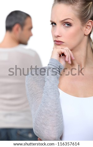 Blond woman grimacing - stock photo