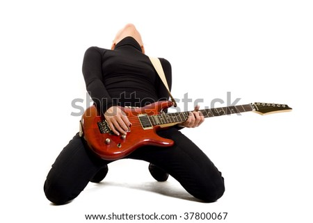 blond woman guitarist playing her guitar with passion