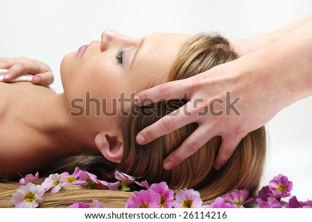 blond woman having massage in spa - stock photo