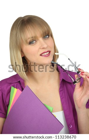 Blond woman holding her glasses and business documents - stock photo