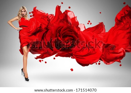 blond woman in beautiful blown rose dress - stock photo