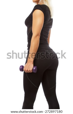 Blond woman in black sportswear doing exercises with dumbell. Isolated on white - stock photo