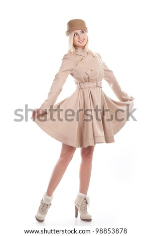 blond woman in coat on a white bg