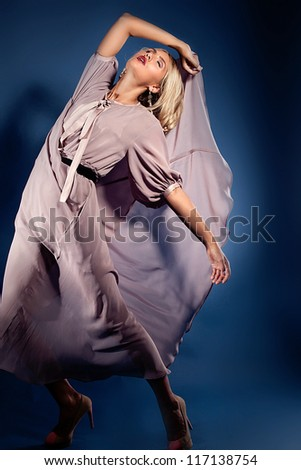 Blond woman  in fashionable billowing dress - stock photo