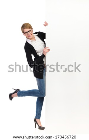 Blond woman in high heels holding banner. Head and shoulders studio shot isolated on white. - stock photo