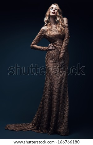 blond woman in long gold dress - stock photo