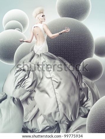 blond woman in magnificent grey dress with creative hairstyle - stock photo