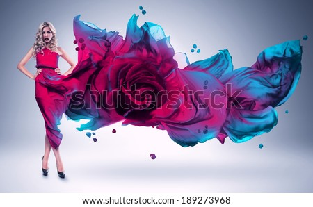blond woman in pink and blue rose dress - stock photo