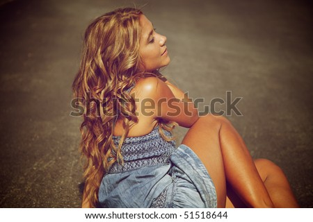 Blond woman on the road - stock photo