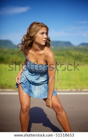 Blond woman on the road looking away