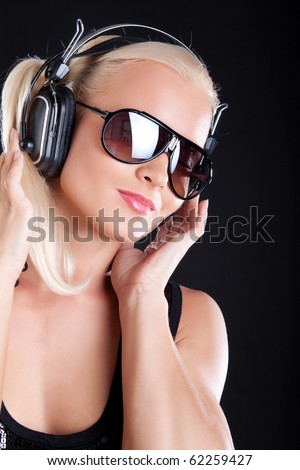 Blond woman posing with headphones