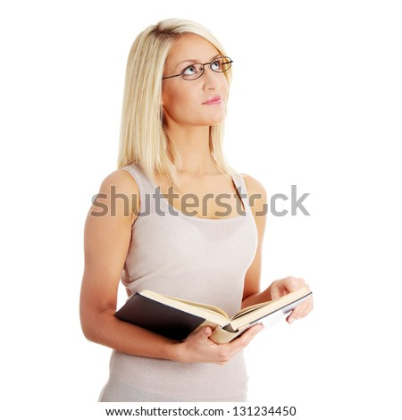 Blond woman reading book , isolated on white background