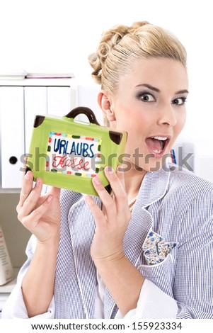 Blond woman showing holiday cash box