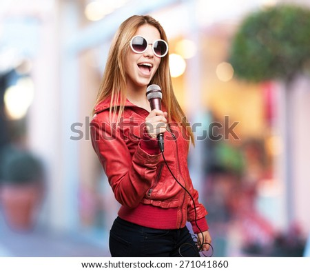 blond woman singing - stock photo