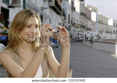 Blond woman taking picture