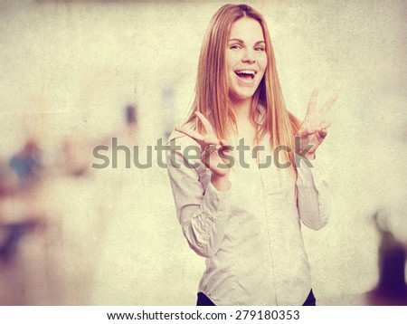 blond woman victory sign