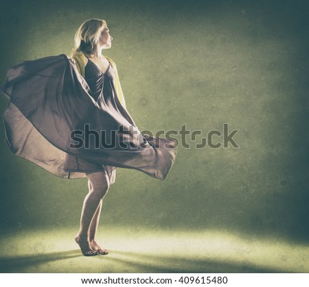 blond woman wearing green scarf on vintage background