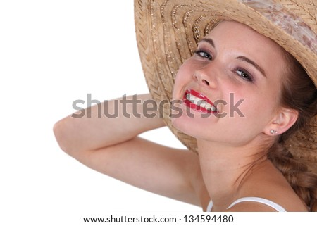 Blond woman with a hat on. - stock photo