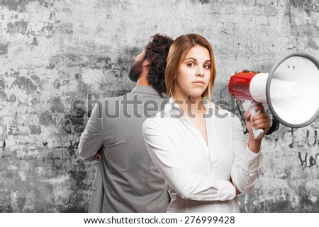 blond woman with a megaphone - stock photo