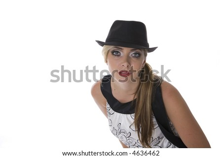 Blond woman with big blue eyes dressed retro with black hat isolated on white.