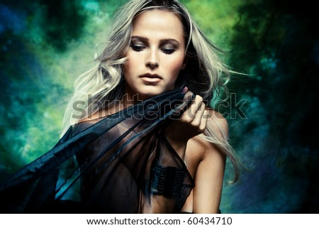 blond woman with black veil studio shot - stock photo