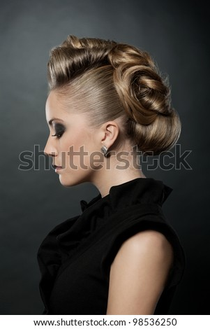 Blond woman with fashion hairstyle, eyes down. - stock photo