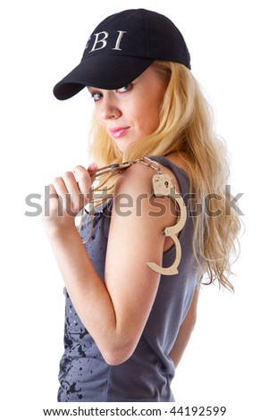 Blond woman with handcuffs. Isolated on white background - stock photo