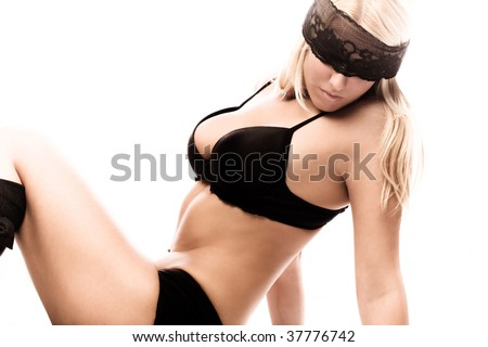 blond woman with lace cover over eyes, studio white - stock photo