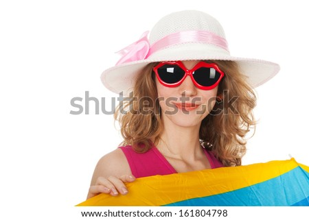 blond woman with lang hair and sunglasses behind the parasol at the beach