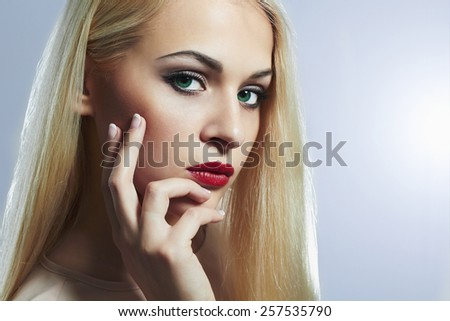 Blond woman with manicure.Beautiful girl model with make-up. red lips - stock photo