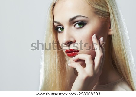 Blond woman with manicure.Beautiful girl model with make-up. red lips