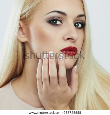 Blond woman with manicure.Beautiful girl model with perfect skin, evening make-up and white color nails.Nail design - stock photo