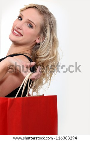 Blond woman with red bag - stock photo
