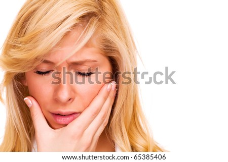 Blond woman with toothache, isolated on white